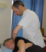 Working on a patient at one of the osteopath clinics